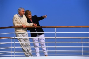 man and woman on deck of cruise ship